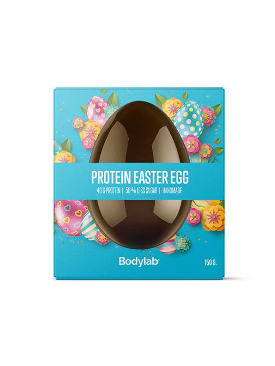 Bodylab čokoladno proteinsko jaje u plavoj kutiji.