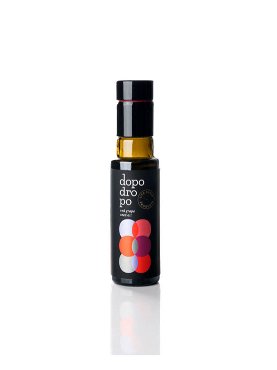 Dopo Dropo cold pressed red grapeseed oil in a dark bottle of 100ml